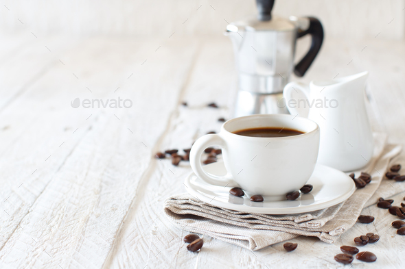 Cup of coffee with milk on a rustic wooden background close up - Stock Photo - Images