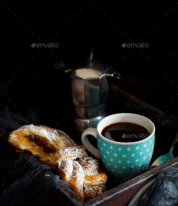 Cup of coffee with croissant on a dark background close up - Stock Photo - Images