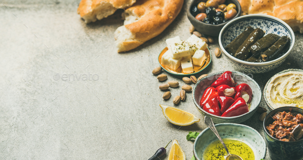 Mediterranean or Middle Eastern meze starter fingerfood assortment, wide composition - Stock Photo - Images