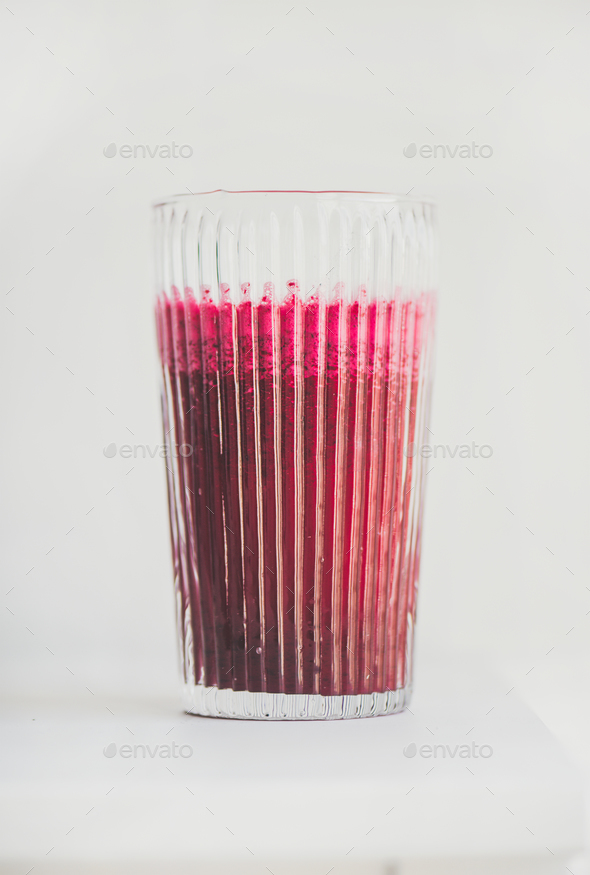 Fresh detox beetroot smoothie in glass, white background, copy space - Stock Photo - Images