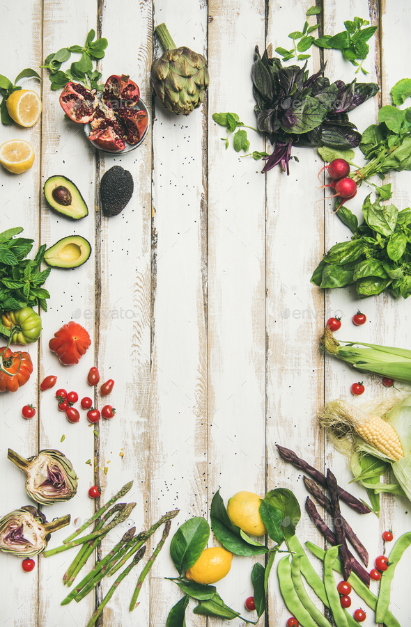 Healthy raw summer vegan ingredients over wooden background - Stock Photo - Images