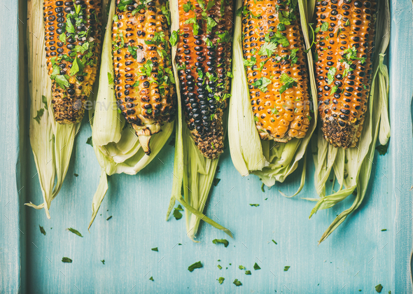 Grilled sweet corn with pesto sauce and herb, copy space - Stock Photo - Images