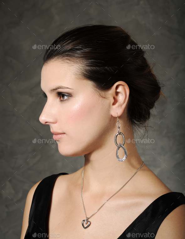 beautiful woman in silver jewelry - Stock Photo - Images