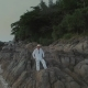 Man in White on Sunset Beach in Thailand Rocks - VideoHive Item for Sale