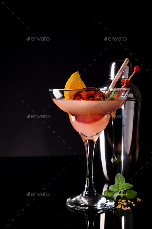 French daiquiri, alcohol cocktail with lemon juice, sugar syrup, cognac, mint and orange - Stock Photo - Images