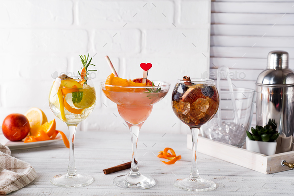 Different alcoholic drink in glass with Bar accessories on white wooden background - Stock Photo - Images