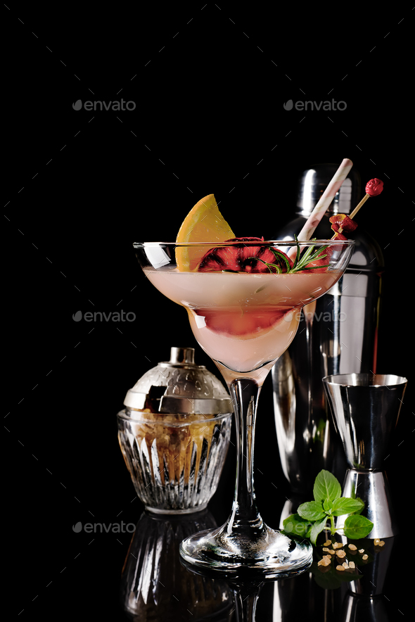 Refreshing alcoholic cocktail margarita with citrus fruits on black glass background - Stock Photo - Images
