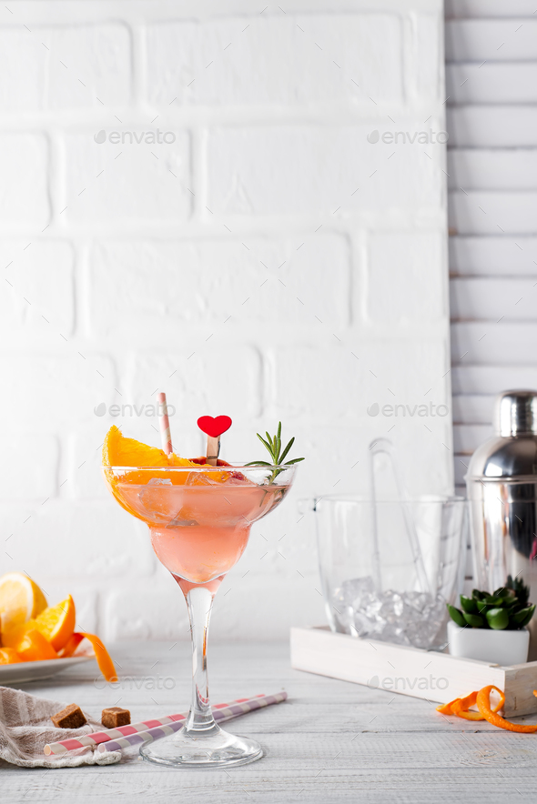 Frozen Margarita or Daiquiry Cocktail with rosemary, fresh orange and grapefruit juice - Stock Photo - Images