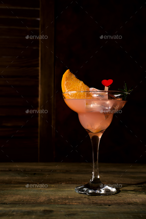 Ice cold Margarita Cocktails in stem glasses on dark wooden backgorund, copy space - Stock Photo - Images