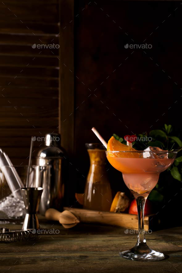 Frozen margarita cocktail in margarita glass on dark wooden backgorund - Stock Photo - Images