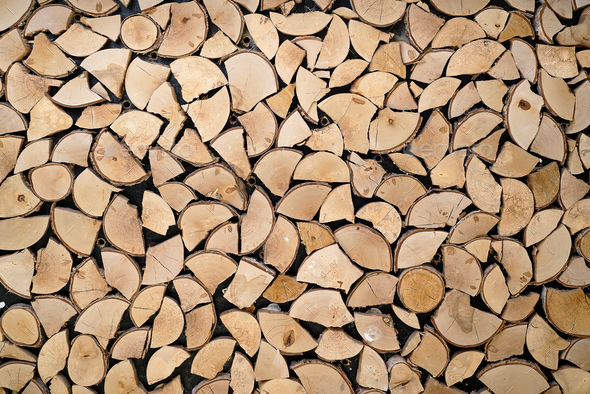 Abstract photo of a pile of natural wooden logs background - Stock Photo - Images