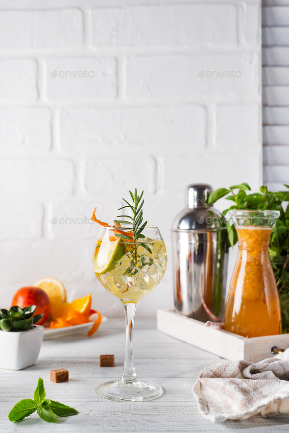 Fresh mojito drink with rosemary, lemon and orange on white wooden backgorund, copy space - Stock Photo - Images
