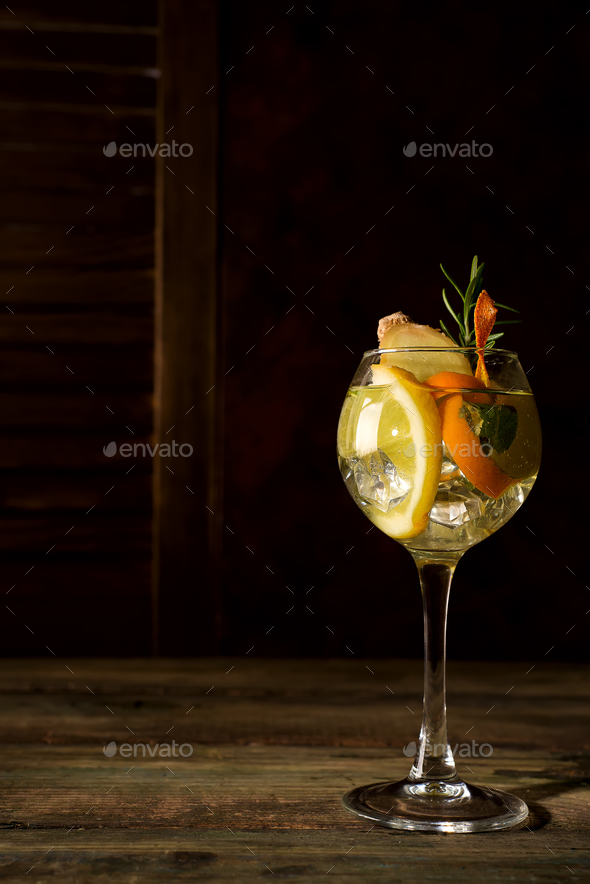 Fresh mojito drink placed on dark wooden backgorund, copy space - Stock Photo - Images