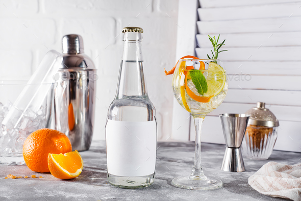 Alcohol drink (gin tonic cocktail) with lemon, rosemary and ice - Stock Photo - Images