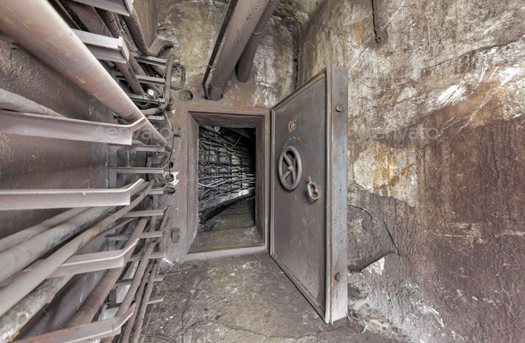 An open protective door in an underground communication tunnel - Stock Photo - Images