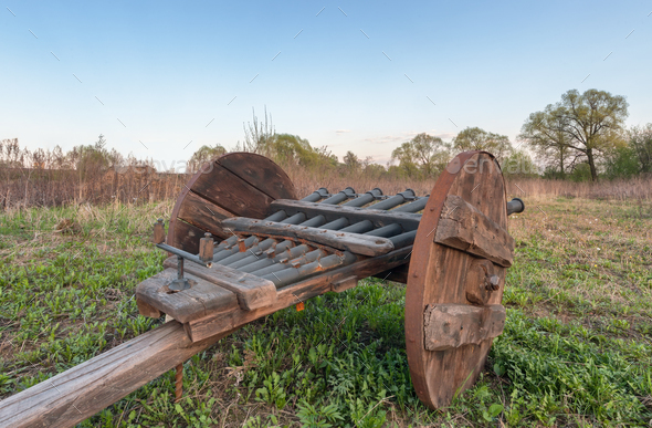 An old cannon with several gun barrels with a wooden carriage, a side view - Stock Photo - Images