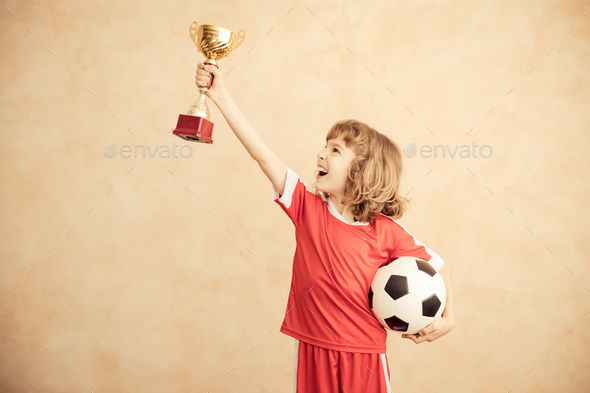 Child is pretending to be a soccer player - Stock Photo - Images