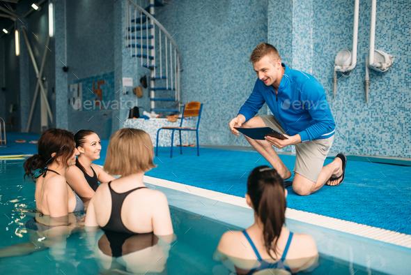Female fitness class with trainer, aqua aerobics - Stock Photo - Images