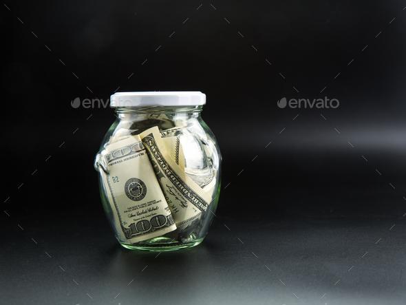 Money saving concept, glass jar full of dollars - Stock Photo - Images