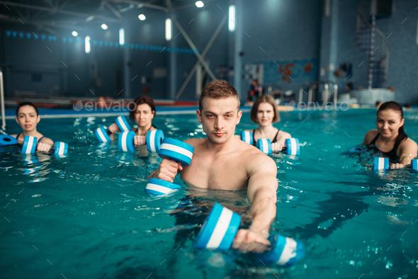 Trainer and female aqua aerobics group, swimming - Stock Photo - Images