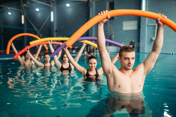 Instructor and class on workout in swimming pool - Stock Photo - Images