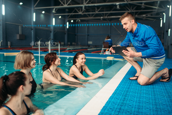 Female fitness class with trainer, aqua aerobics - Stock Photo - Images