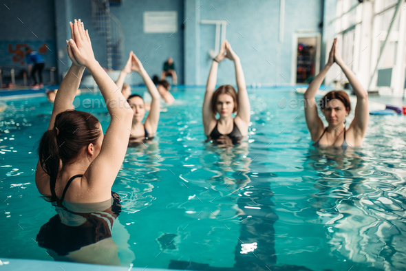 Female group on aqua aerobics in swimming pool - Stock Photo - Images