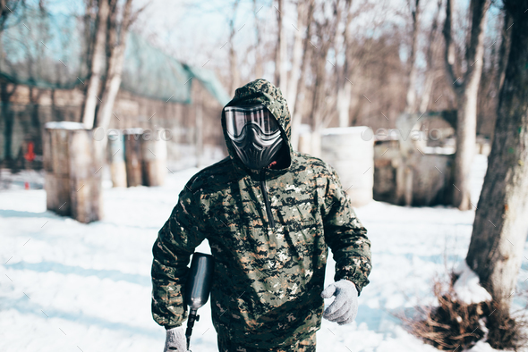 Male paintball player, military game equipment - Stock Photo - Images