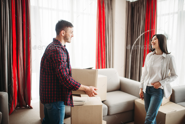 Couple arrange boxes, moving to new house - Stock Photo - Images