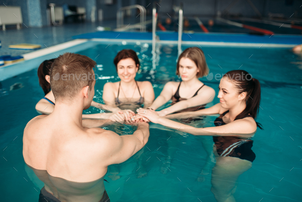 Trainer and female group, aqua aerobics training - Stock Photo - Images