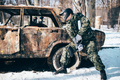Paintball battle, burned car in winter forest - PhotoDune Item for Sale