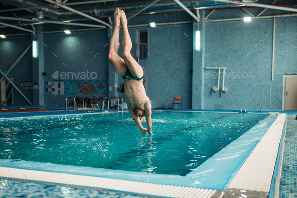 Swimmer in goggles jumping from the tower - Stock Photo - Images