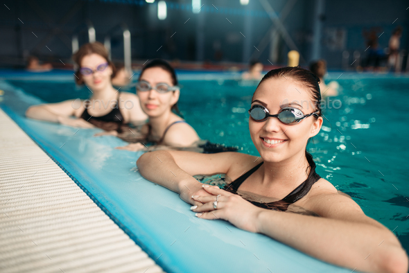 Female swimmers in goggles, swimming pool - Stock Photo - Images