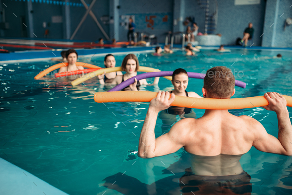 Instructor and group on workout in swimming pool - Stock Photo - Images