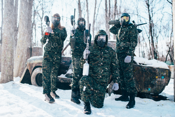 Paintball team poses with marker guns - Stock Photo - Images