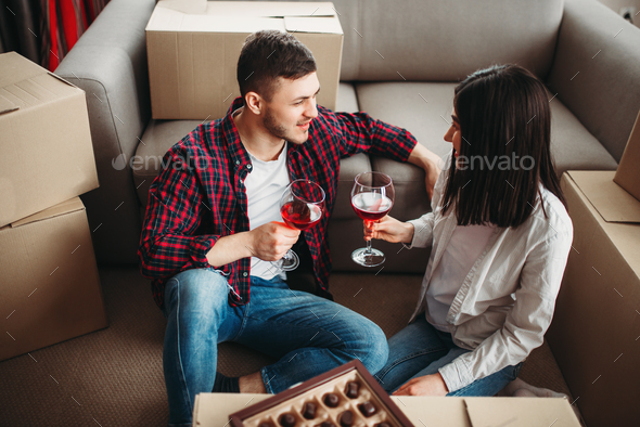 Happy couple celebrate moving to new house - Stock Photo - Images
