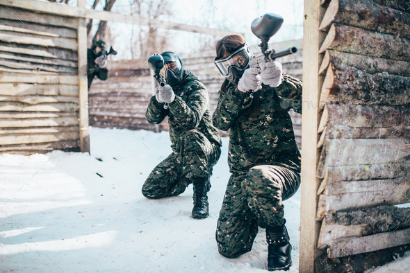Paintball team, players in winter battle - Stock Photo - Images