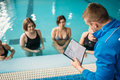 Group with trainer, aqua aerobics in swimming pool - PhotoDune Item for Sale