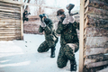 Paintball team, players in winter battle - PhotoDune Item for Sale