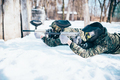 Two paintball players lies on the snow - PhotoDune Item for Sale