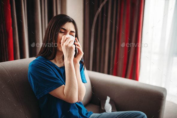 Stressed woman crys and eats chocolate - Stock Photo - Images