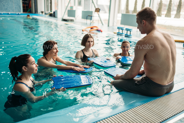 Trainer works with aqua aerobics group, swimming - Stock Photo - Images