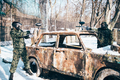 Paintball players shoots because of burned car - PhotoDune Item for Sale