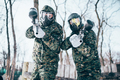 Paintball players in splattered masks after battle - PhotoDune Item for Sale