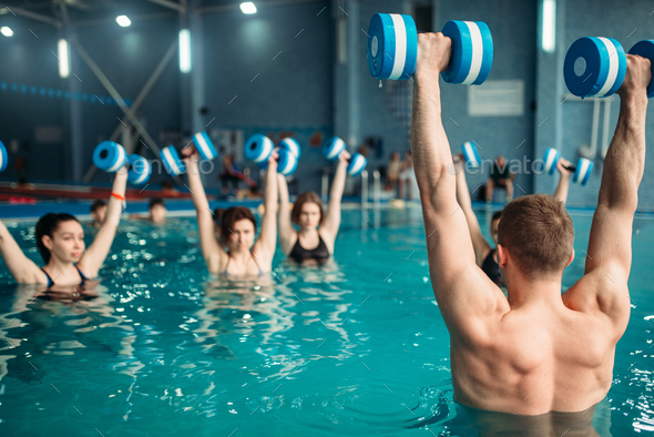 Class with trainer on workout with aqua dumbbells - Stock Photo - Images