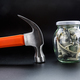 Hammer against jar full of dollars, money saving - PhotoDune Item for Sale