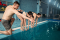 Instructor and female swimmers in swimming pool - PhotoDune Item for Sale