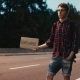Young Man Hitchhiking with Sign on the Road at Night - VideoHive Item for Sale