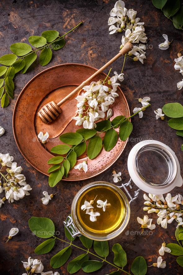 Acacia honey in jar - Stock Photo - Images