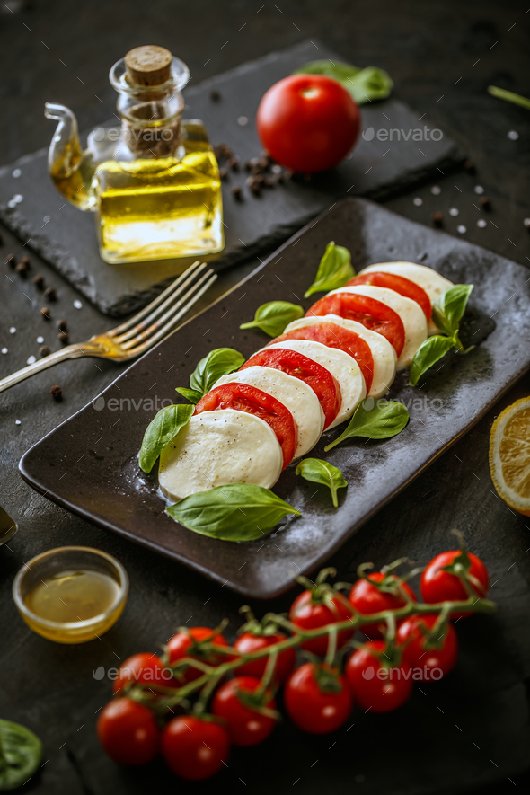 Platter with mozzarella cheese and tomatoes - Stock Photo - Images